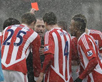 Stoke players remonstrate with referee Martin Atkinson after Robert Huth is sent off against Sunderland. ACTION IMAGES