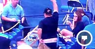 Image: Video still of a baseball fan holding up a foul ball while grabbing for his falling shorts (andrewop0lis via YouTube, http://aka.ms/ballpants)