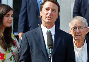 Image: John Edwards speaks outside a federal courthouse with daughter Cate Edwards (left) & father Wallace Edwards (right) after the jury's verdict in his trial in Greensboro, NC (© Chuck Burton/AP)