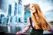 A young Russian woman on a modern city background. Moscow HDR image