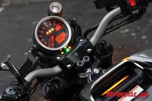 A large tachometer figures front and center with an inset digital speedometer. Tank-top info screen is small and hard to see while riding.