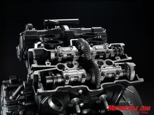 Exhaust cams are gear-driven by the chain-driven intake cams.