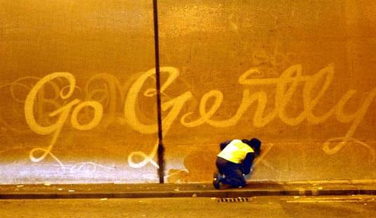 REVERSE GRAFFITI: Street Artists Tag Walls by Scrubbing Them Clean