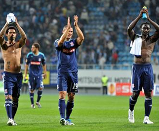 Jermaine Pennant, Jon Walters and Kenwyne Jones applaud the visiting supporters in Kiev. ACTION IMAGES