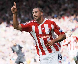 Jon Walters celebrates scoring a penalty against Liverpool. ACTION IMAGES