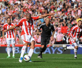 Jon Walters fires home a penalty against Liverpool. ACTION IMAGES