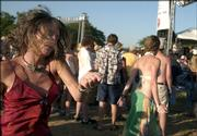 Summer Thompson, of Bishop, Calif., dances to Little Feat in front of the Sun Down stage at the Wakarusa Music & Camping Festival on Sunday evening. Thompson came to the festival to sell her silks, and said she enjoyed all four days of the event.
