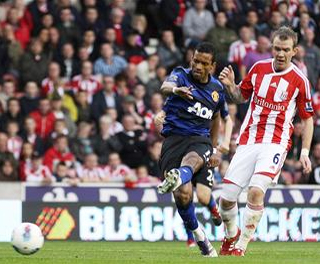 Glenn Whelan can only look on as Nani scores for Manchester United. ACTION IMAGES
