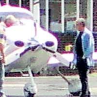 Sir Alan inspects damaged plane