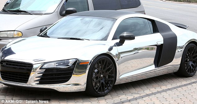 Show off, much? Scott has develped a passion for quirky cars, with his most recent addition being a chrome Audi R8