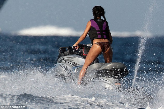 Wild ride: The singer was confident on the jet ski and was seen standing up as she made a splash