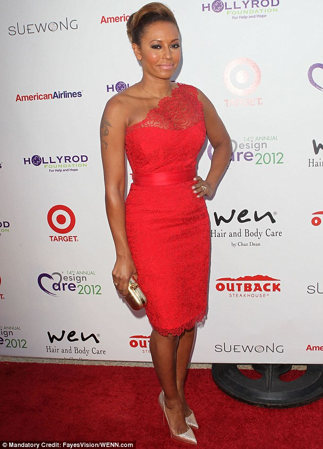 Lady in red: Mel B looked chic and sophisticated in her red lace gown last night
