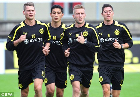 In demand: Robert Lewandowski (above right) is a target for Chelsea