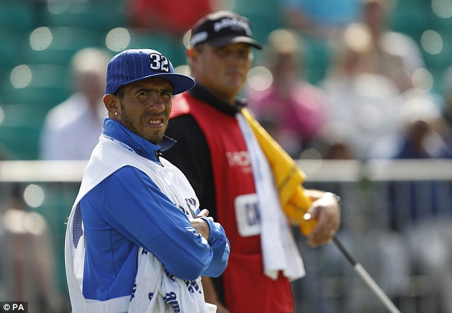 Change of scenery: Carlos Tevez is caddying for Argentina's Andres Romero during day four of The Open