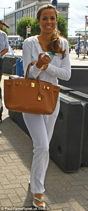 That's my name! Mrs Humes grins as she steps out in her personalised tracksuit
