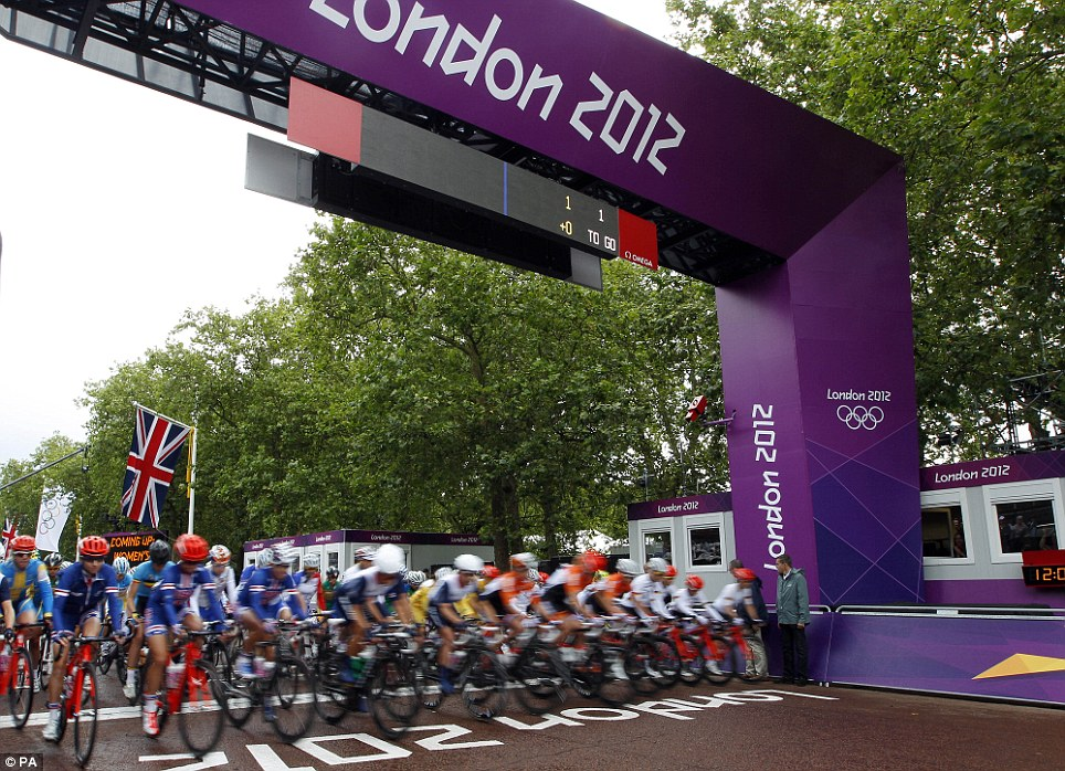 Cyclists leave the starting line during the Women's Road Cycling race at the 2012 Summer Olympics