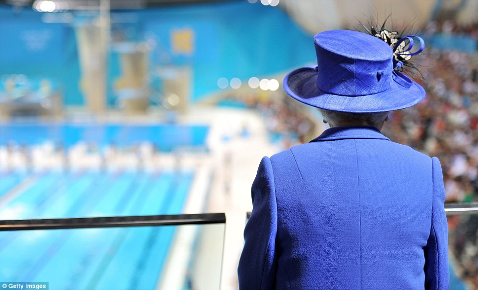 The Queen watches the morning session of the swimming at the Aquatics Centre during a tour of the Olympic Park on day one of the London 2012 Games
