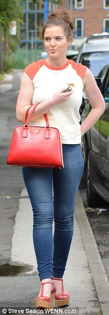 Helen looked casual in her jeans and T-shirt today but loves to wear her sister's designs to events