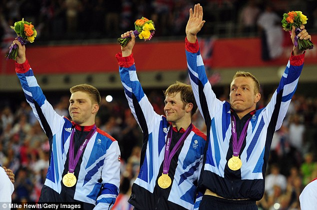 Team effort: Philip Hindes, Jason Kenny and Chris Hoy wave to the patriotic crowd in the Velodrome after receiving their medals