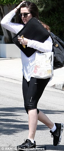 Practical: Khloe ditched her favourite heels for a pair of practical trainers for the appointment