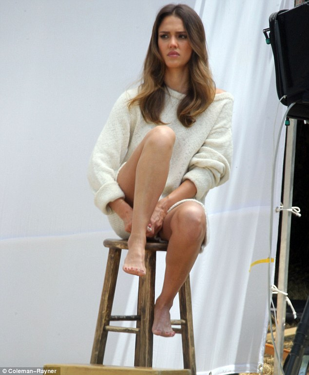 Now for my moody look: Alba sat on a stool against a white backdrop and struck a sultry pose