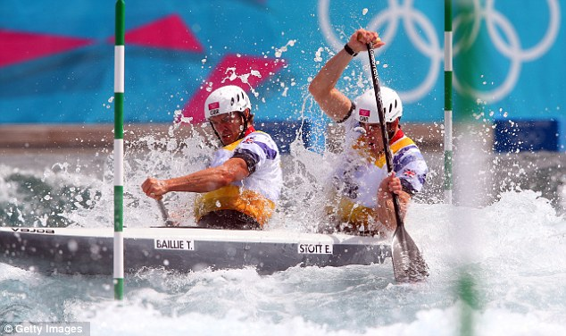 Holding firm: Tim Baillie and Stott battle the waves on their way to a gold medal