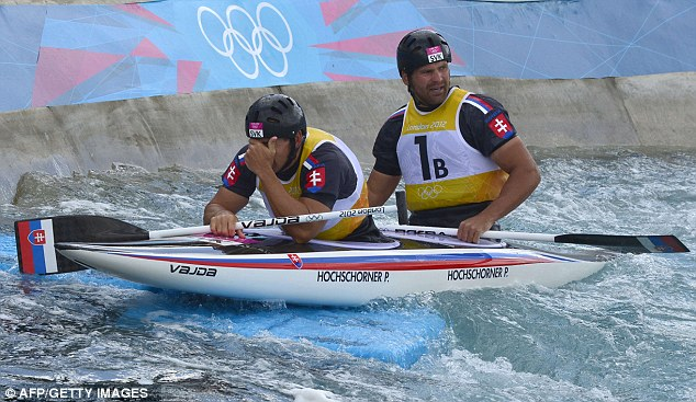 Gutted: Olympic chamions Slovakia's Pavol (left) and Peter Hochschorner had to settle for bronze