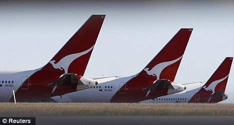 Qantas airline planes. The company said it had no record of any caller waiting 15 hours on hold