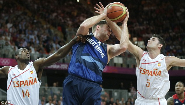 Outnumbered: Robert Archibald is pressured by Spain's Rudy Fernandez, right and Serge Ibaka