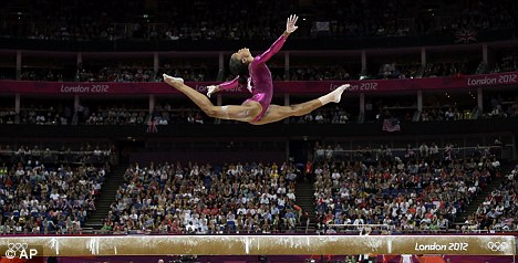 Brilliant: Douglas performs on the balance beam during the final