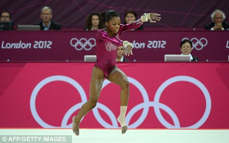 Special win: Gabrielle Douglas performs on the beam on Thursday