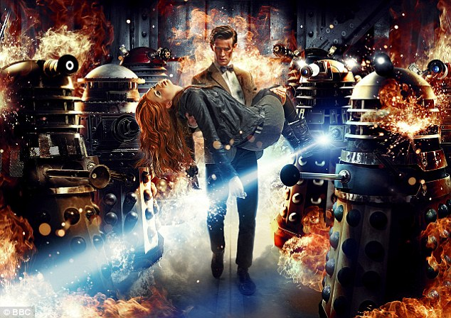 Terrifying: The Doctor carries Amy Pond through a wall of fire, while flanked by two rows of terrifying Daleks