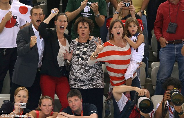 Team Phelps: The swimmer's family cheer him on