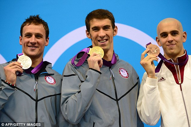 Golden moment: Michael Phelps clutches his 15th Olympic gold medal - and 20th in total