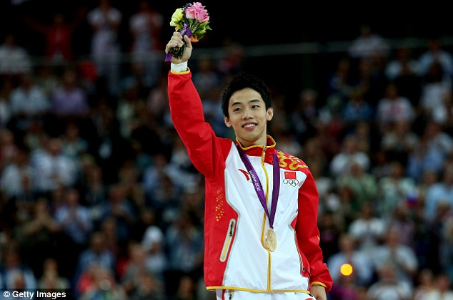 Pure gold: China;s Kai Zou celebrates men's floor final at North Greenwich Arena