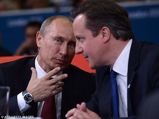 Power Games: Putin and Cameron watch the judo at the Olympics earlier this week