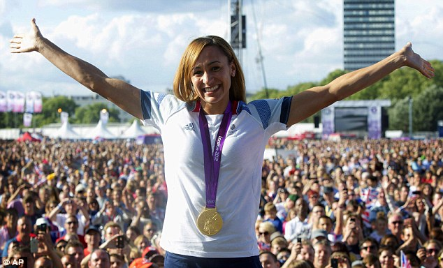 Golden girl: Jessica Ennis celebrates the day after her night of glory
