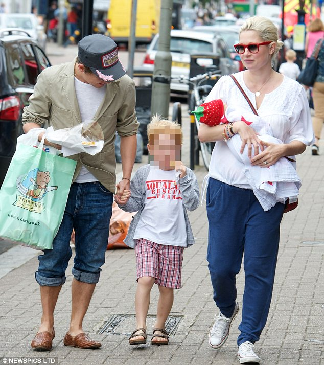 Fox's first prowl: Mark Owen and wife Emma were seen with their baby daughter for the first time during a shopping trip in Wandsworth on Friday