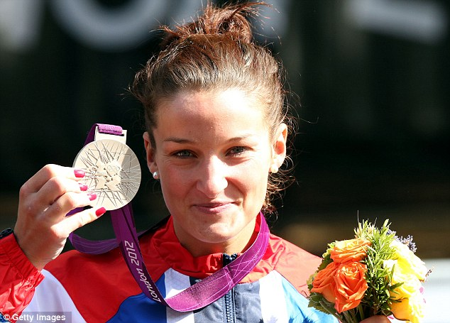 Smiles better: Lizzie Armitstead shows off her silver medal from the women's road race