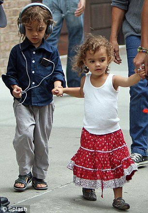 Livin' la Vida Loca: Both Vida and Levi's wild curls were on display as the siblings held hands and mum led the way