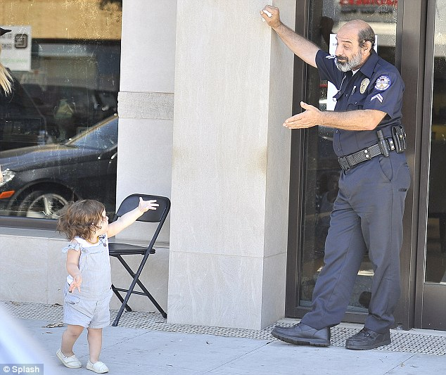 Friends in high places: Skyler exchanges a few pleasantries with a police officer