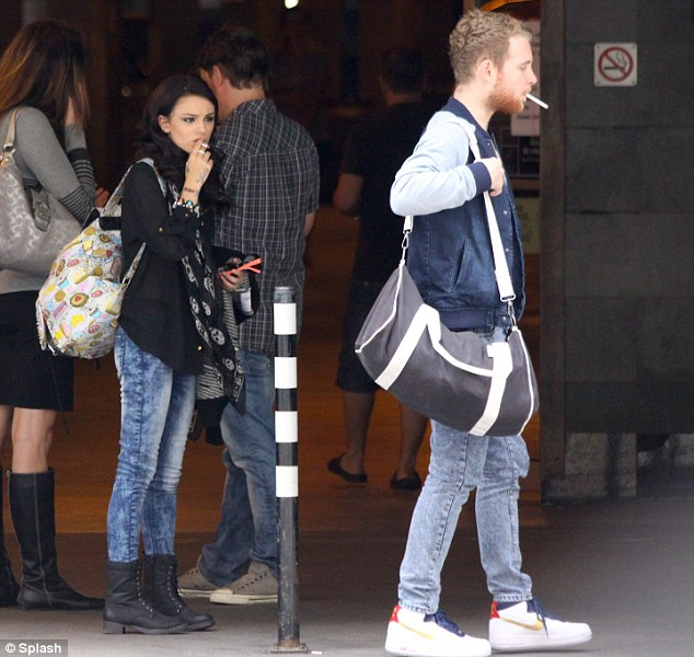 You shouldn't be doing that there... Cher Lloyd was pictured yesterday with her fiancé Craig Monk in Montreal smoking in a No Smoking area