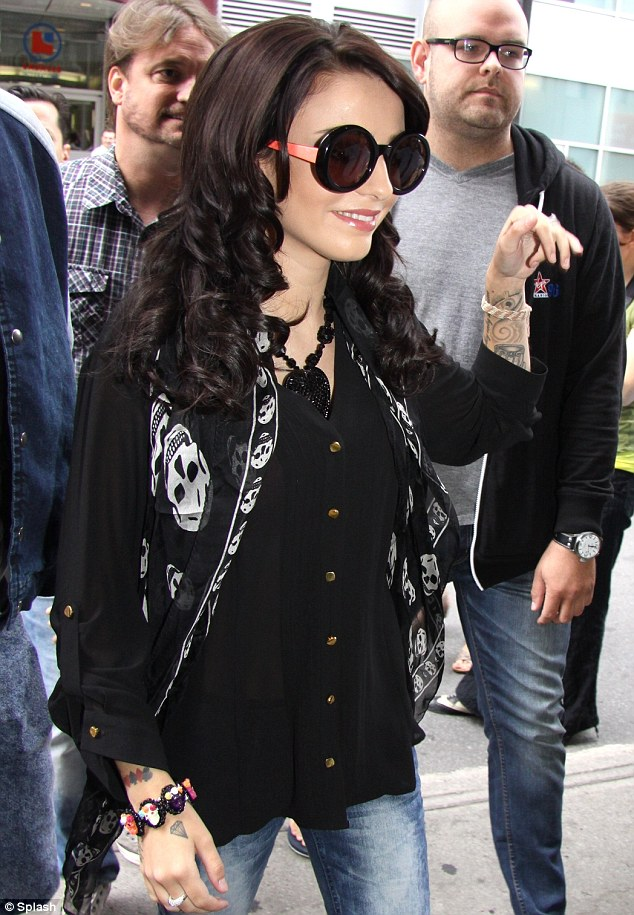 In demand: Lots of Cher's fans turned out to greet the young singer as she arrived at Virgin Radio