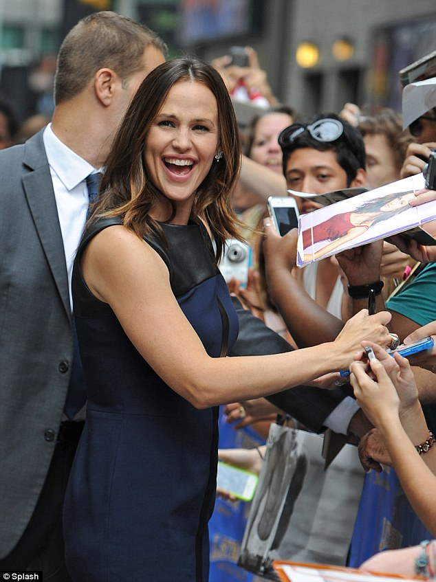 Signing autographs: Even after a long day of promotional work, Jennifer was still delighted to meet her fans