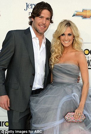 So in love: Carrie with NHL player husband Mike Fisher in May