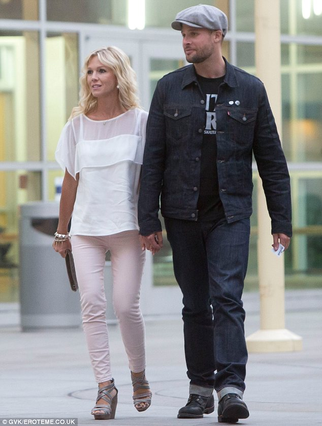Budding romance: The Beverly Hills, 90210 star and her male companion walked hand in hand as they left the Hollywood cinema