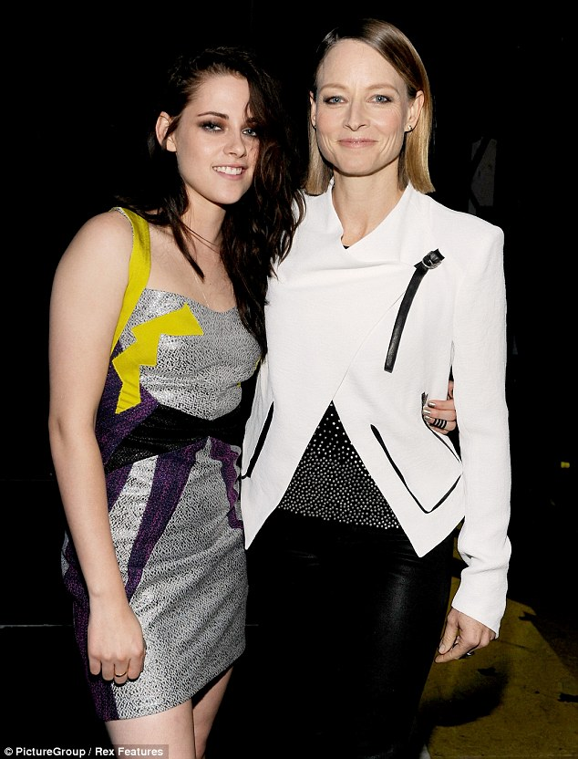 Proud 'mum': Jodie Foster and Kristen Stewart, pictured here at the MTV Movie Awards in June, starred together in Panic Room over a decade ago