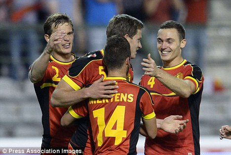 Dutch courage: Belgium players celebrate another goal against Holland
