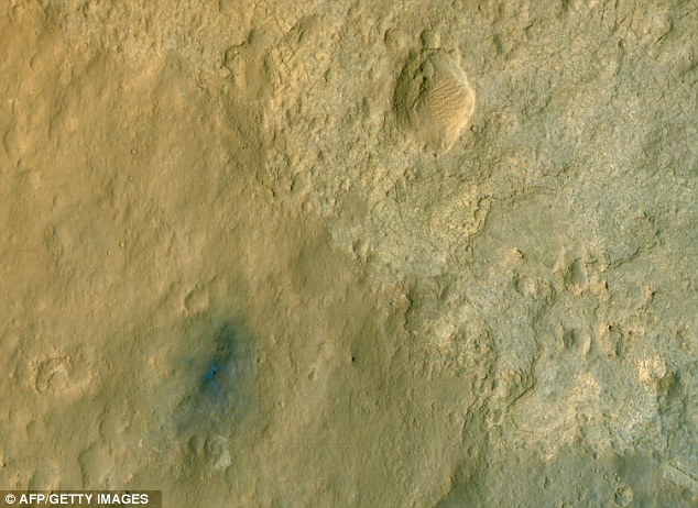 Blue moon: Colour-enhanced view of Nasa's Curiosity rover. The blue shading shows the area where the rocket landed