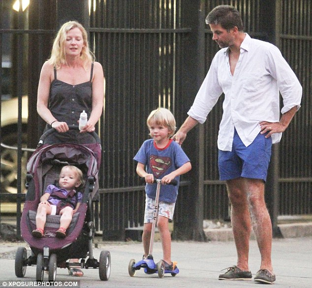 Family time: Broadwalk Empire star Gretchen Mol and husband Kip Williams enjoy a day out and about in New York with their Son Ptolemy and daughter Winter